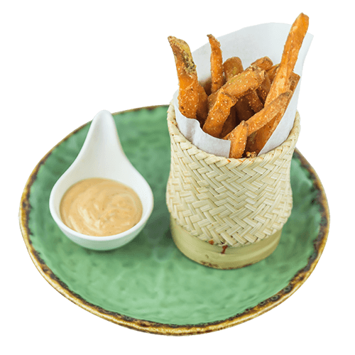 sweet potato fries on a green plate